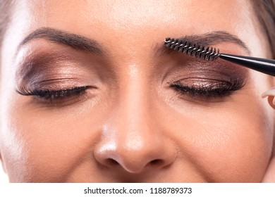 Eyeliner, color enhancement of skin on the face, eyelids, lips, and eyebrows applied with permanent makeup