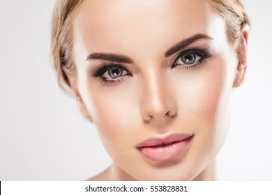 Eyes Beauty Woman face Portrait close up. Beautiful model Girl with Perfect Fresh Clean Skin Lips