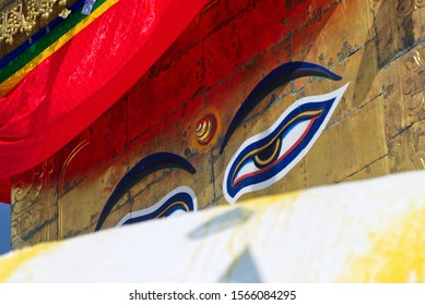 Eyes of Buddha or wisdom eyes of Buddha in Monkey temple or Swayambhunath stupa and prayer flag, an ancient religious architecture atop a hill, buddhist monastery in Kathmandu Valley, Nepal