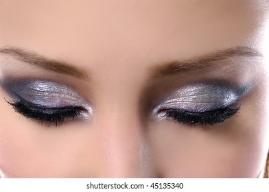 Eyes closed.- glamour ceremonial make-up