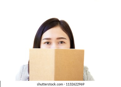 Eyes contact of Asian business women age between 25-30 years old behind her notebook.  isolated object on white background.