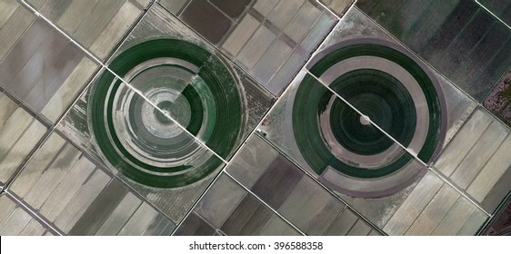 the eyes of the field,abstract photography of the Spain fields from the air, bird's eye view, tribute to Pollock, artistic representation of human labor camps, abstract expressionism,contemporary art