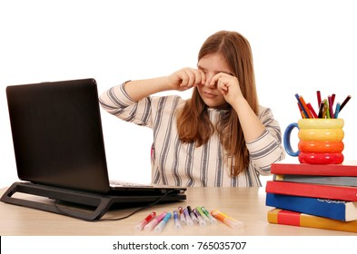 The eyes of the little girl were tired of the long use of the laptop