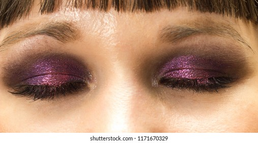 eyes makeup closeup with purple smoky eyeshadow