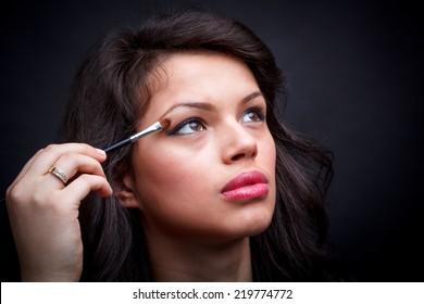 Eyes Makeup. Woman with eye shadow brush