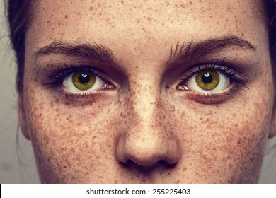 Eyes nose woman portrait with freckles
