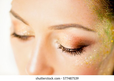 eyes painted sequins closeup