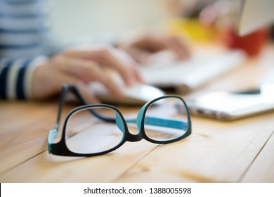 Eyes protecting - Blue Blocking Glasses preventing blue light from LED computer screen which can cause sleeping problem and digital eye strain - Computer Vision Syndrome (CVS) awareness concept