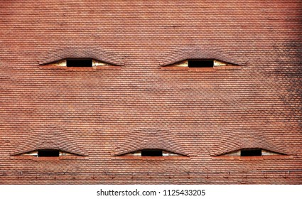 Eyes in the roof - Architectural detail in Sibiu - Hermannstadt, Romania, Europe