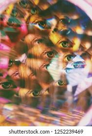 Eyes seen through a kaleidoscope lens