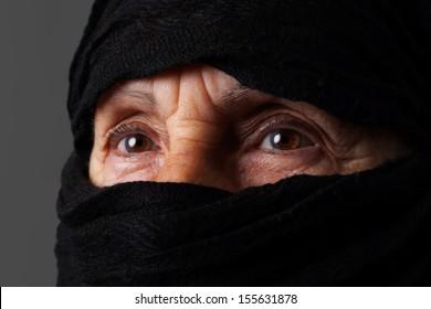 Eyes of senior muslim woman with niqab