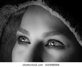 Eyes of a woman looking up, up-close in black and white.