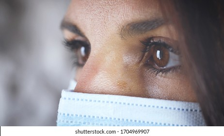 Eyes of woman profile close up. looking with surgical mask.  Concept of prevention of Coronavirus virus Covid 19. Medical dispositive protective for hospitals, dentists. close up