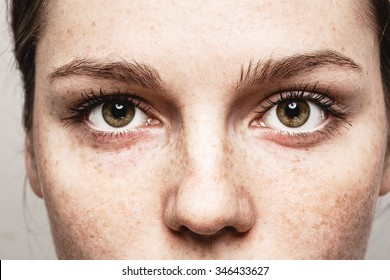 Eyes woman Young beautiful freckles woman face portrait with healthy skin - Shutterstock ID 346433627