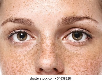 Eyes Young beautiful freckles woman face portrait with healthy skin
