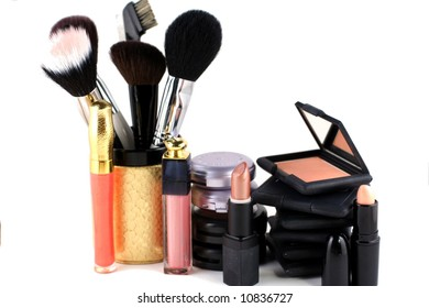eyeshadow and blush makeup display on a white background
