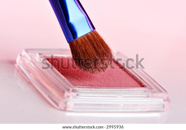 Eyeshadow and brush cosmetics closeup