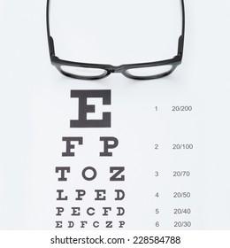 Eyesight test chart with glasses - studio shot