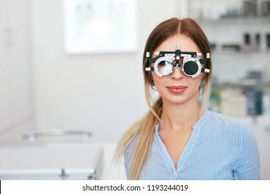 Eyesight Test. Woman In Optometrist Trial Frame At Optometry