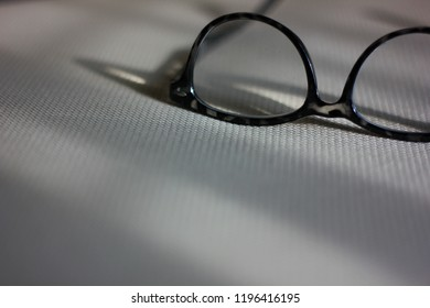eyrglasses on fabricfesk with light from window