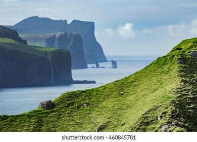 Eystuory, Streymoy Islands and Risin og Kellingin rocks seen from Kalsoy Island. Faroe Islands