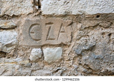 Eza (historic name) written in stone wall in Eze village, French Riviera
