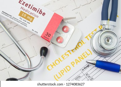 "Ezetimibe drug for cholesterol lowering therapy concept photo. Open packaging with medication tablets, on which written ""Ezetimibe"", lies near stethoscope, result analysis on cholesterol (lipid panel)"