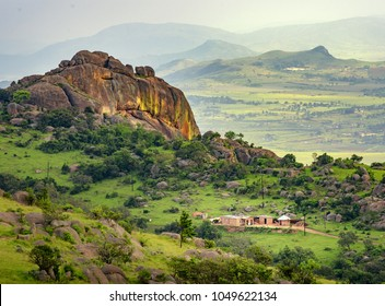 Ezulwini valley in Swaziland eSwatini with beautiful mountains, trees and rocks in scenic green valley between Mbabane and Manzini cities. Traditional huts houses of Swaziland