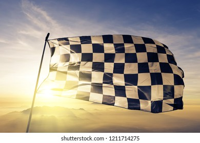 F1 chequered racing flag textile cloth fabric waving on the top sunrise mist fog