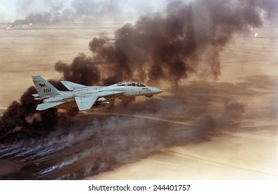 F-14 fighter in flight over burning Kuwaiti oil wells set on fire in March by retreating Iraqi forces were still burning on Aug. 1 1991.