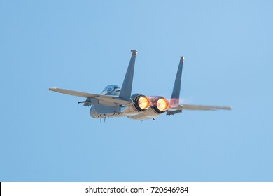 F-15 Eagle in a very close back view, with afterburners on
