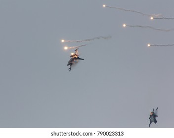 F-16 jets releasing flares during demonstration, replaying a warscene or bombrun
