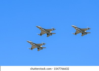 f-16V Viper Fighter Jets flying in formation with clear blue sky background
