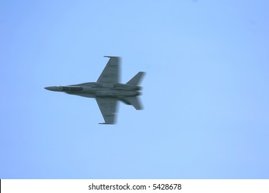 An F-18A Superhornet streaks by at the speed of sound.  The file contains motion blur for effect of speed.