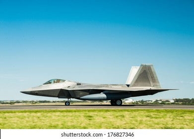 F-22 Raptor fighter bomber on runway.