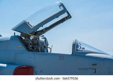 F-5E falcon cockpit under opened canopy at air show. Cockpit Of Fighter Jet.