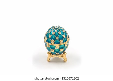 Faberge eggs on white background. Decorative ceramic easter egg for jewellery.