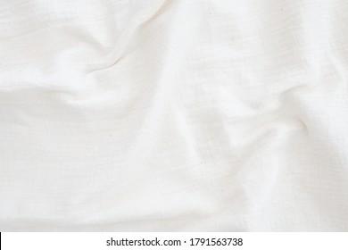 Stoffhintergrund Weiße Leinenplättchen Krummeln natürliches Baumwollgewebe Naturhandgemachte Leinen Draufsicht Organische Eco-Textilien Weiße Stoffstruktur