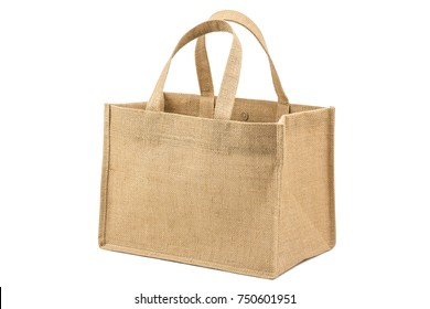 Fabric bag made from hessian sack with handle and magnet clasp isolated on white background