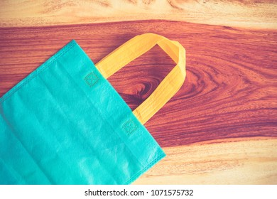 Fabric bag on wooden table.Fabric bag on wooden background.
