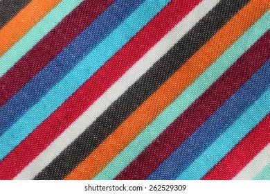 Fabric with colored diagonal stripes. Background and texture.
