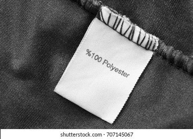 Fabric composition clothes label on black textile background