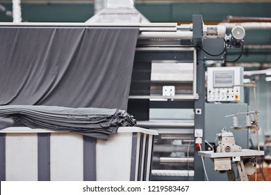 Fabric in containers at a textile factory. Textile factory in spinning production line and a rotating machinery and equipment production company.