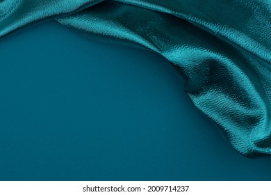 Fabric drapery backdrop abstract background. Shapeless empty surface. luxury metallic elegance blue, cyan, aquamarine color brocade  texture with folds. Сopy space for design