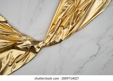Fabric drapery backdrop background. Gold on white marble surface. luxury metallic elegance brocade  texture with folds. Сopy space for design