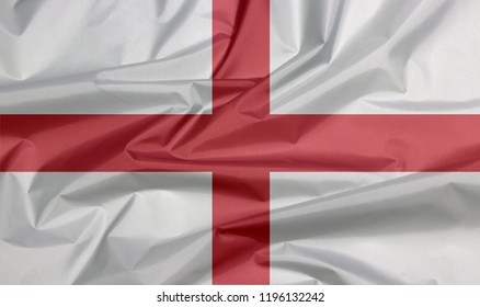 Fabric flag of England. Crease of English flag background, red centred cross on a white background.