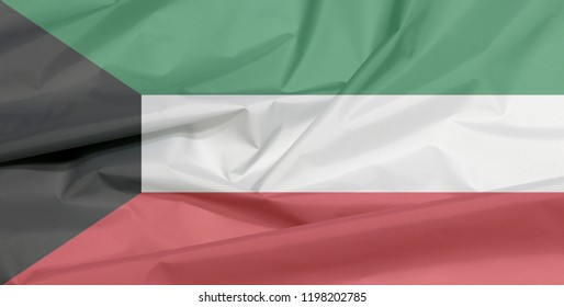 Fabric flag of Kuwait. Crease of Kuwaiti flag background, green white and red color with black trapezium based on the hoist side.