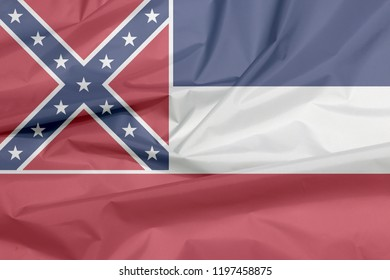 Fabric flag of Mississippi. Crease of Mississippi flag background, The states of America, blue white and red. The canton is square, spans two stripes, red with a blue saltire, with star.