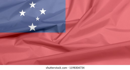 Fabric flag of Samoa. Crease of Samoan flag background, A red field with the blue rectangle and white star.