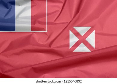 Fabric flag of Wallis and Futuna. Crease of Wallis and Futuna flag background, red saltire on a white square, the flag of France in the upper.